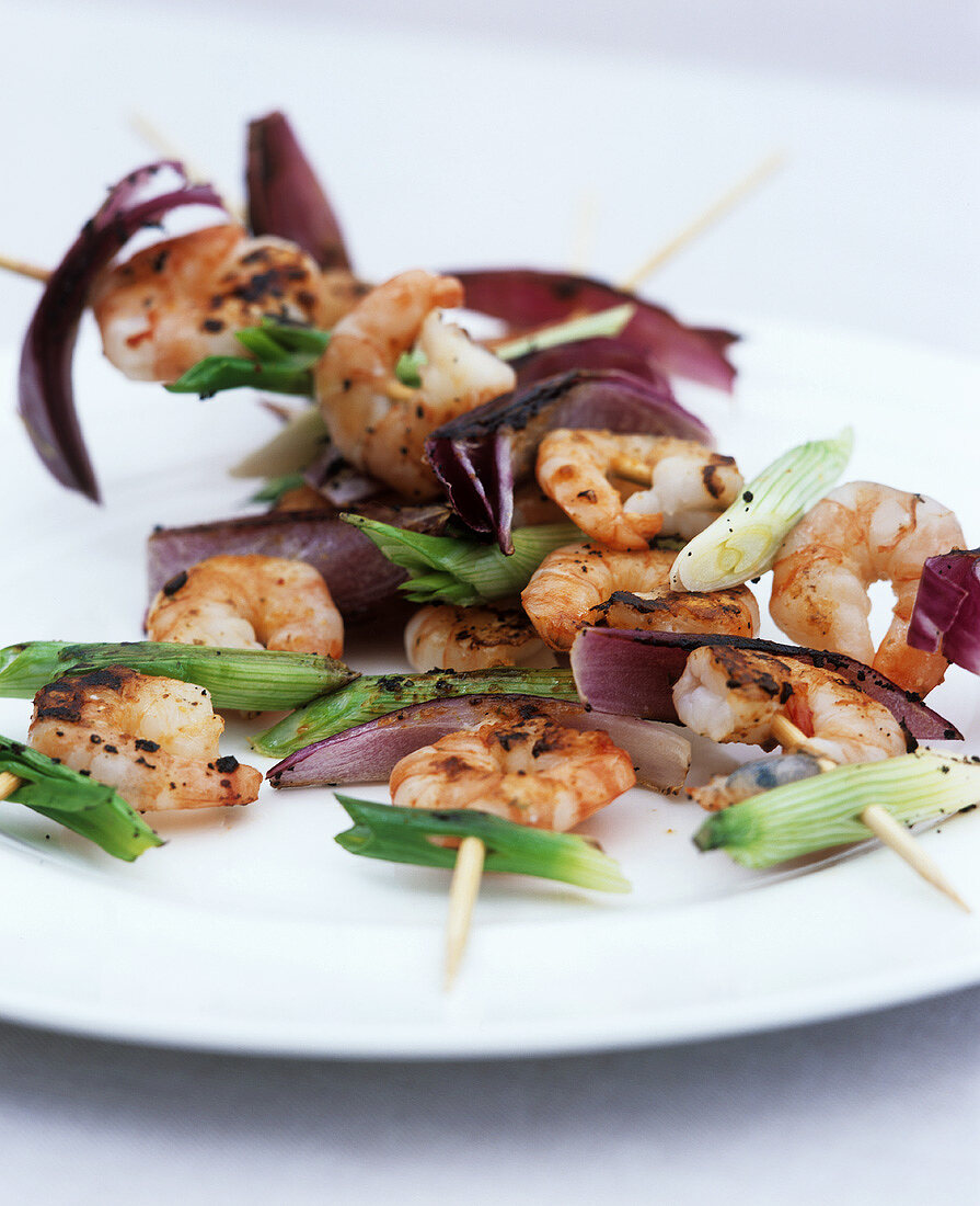 Grilled prawn and onion skewers