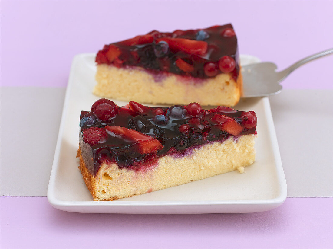 Two pieces of quark cake with red berry compote