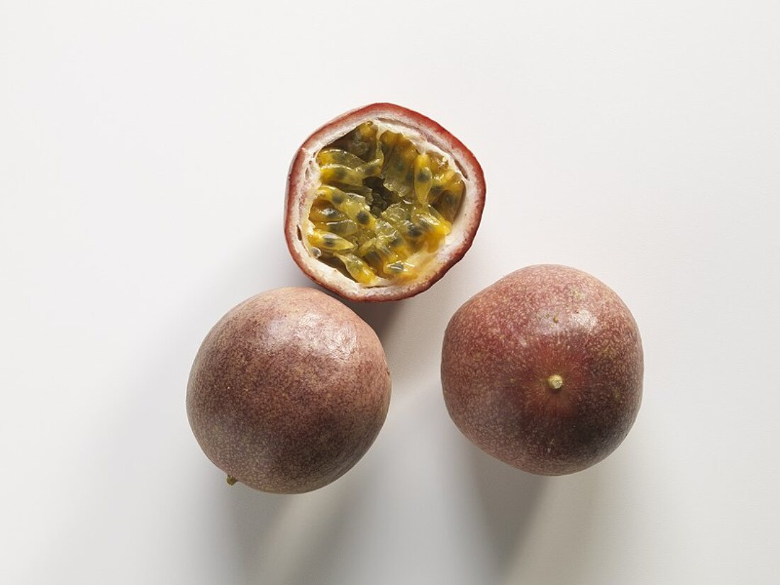 Passion fruits, two whole and one half