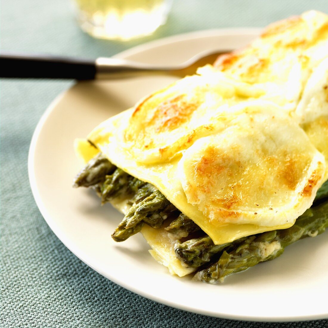 A portion of asparagus lasagne on a plate