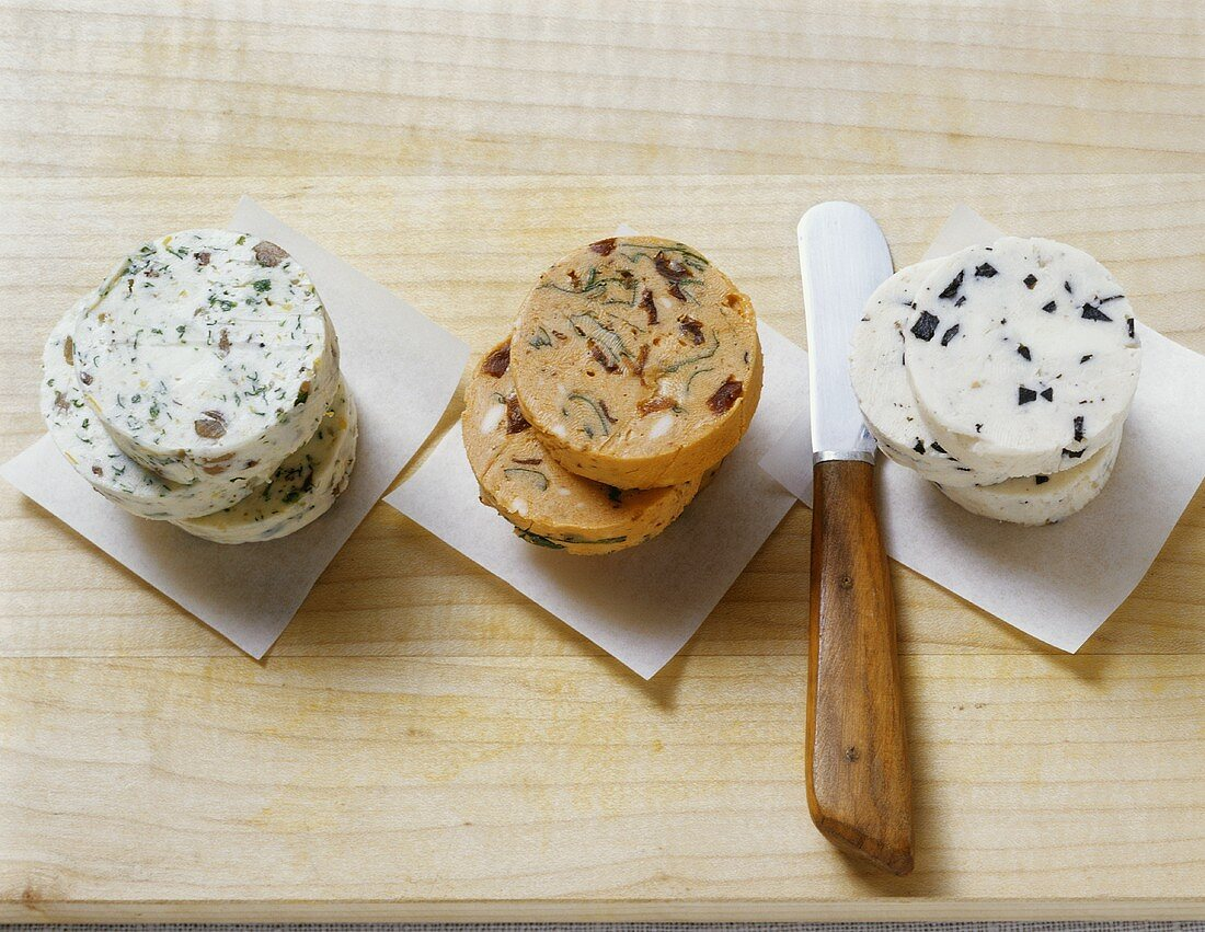 Lemon and anchovy butter, tomato butter, truffle butter