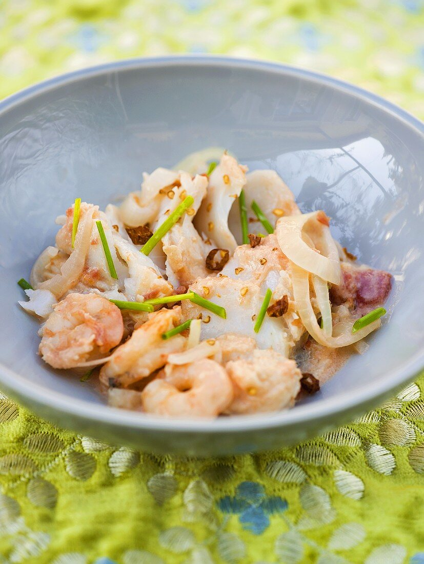 Braised cod with prawns in a dish