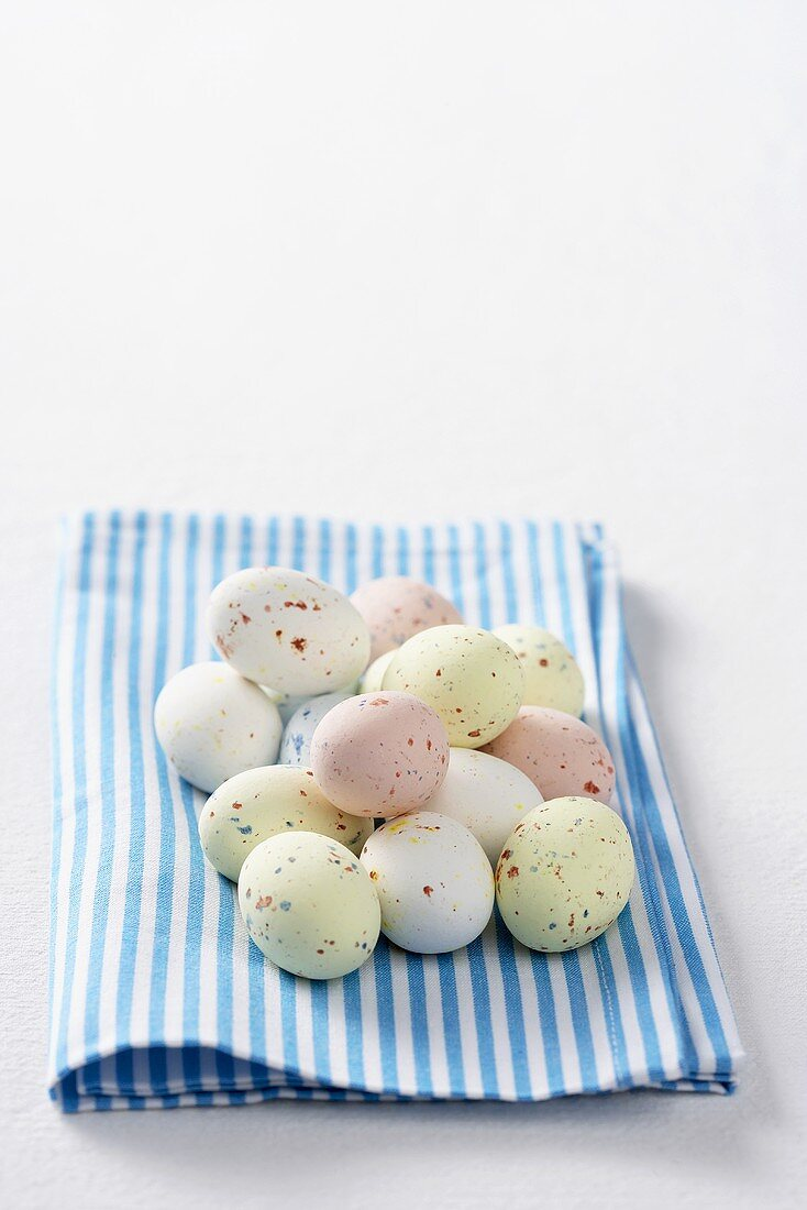 Coloured quails' eggs for Easter on a kitchen cloth
