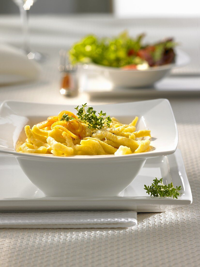Cheese spaetzle (type of noodle) with fried onion rings & thyme