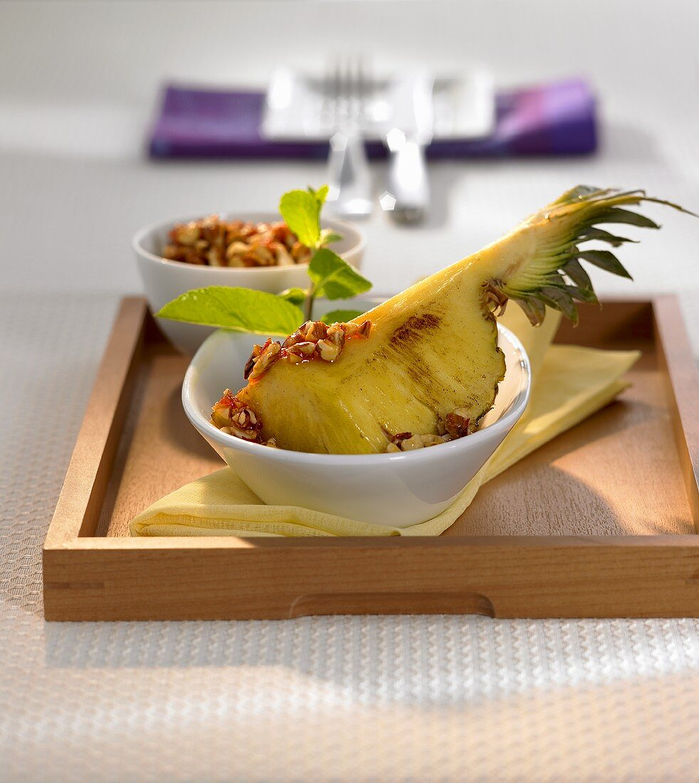 Roasted pineapple with sweet and spicy almond sauce