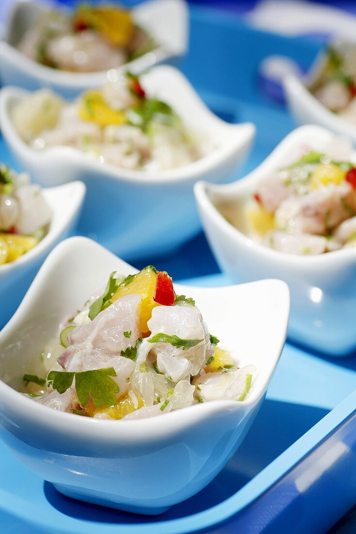 Marinated raw fish salad with chilli and orange segments