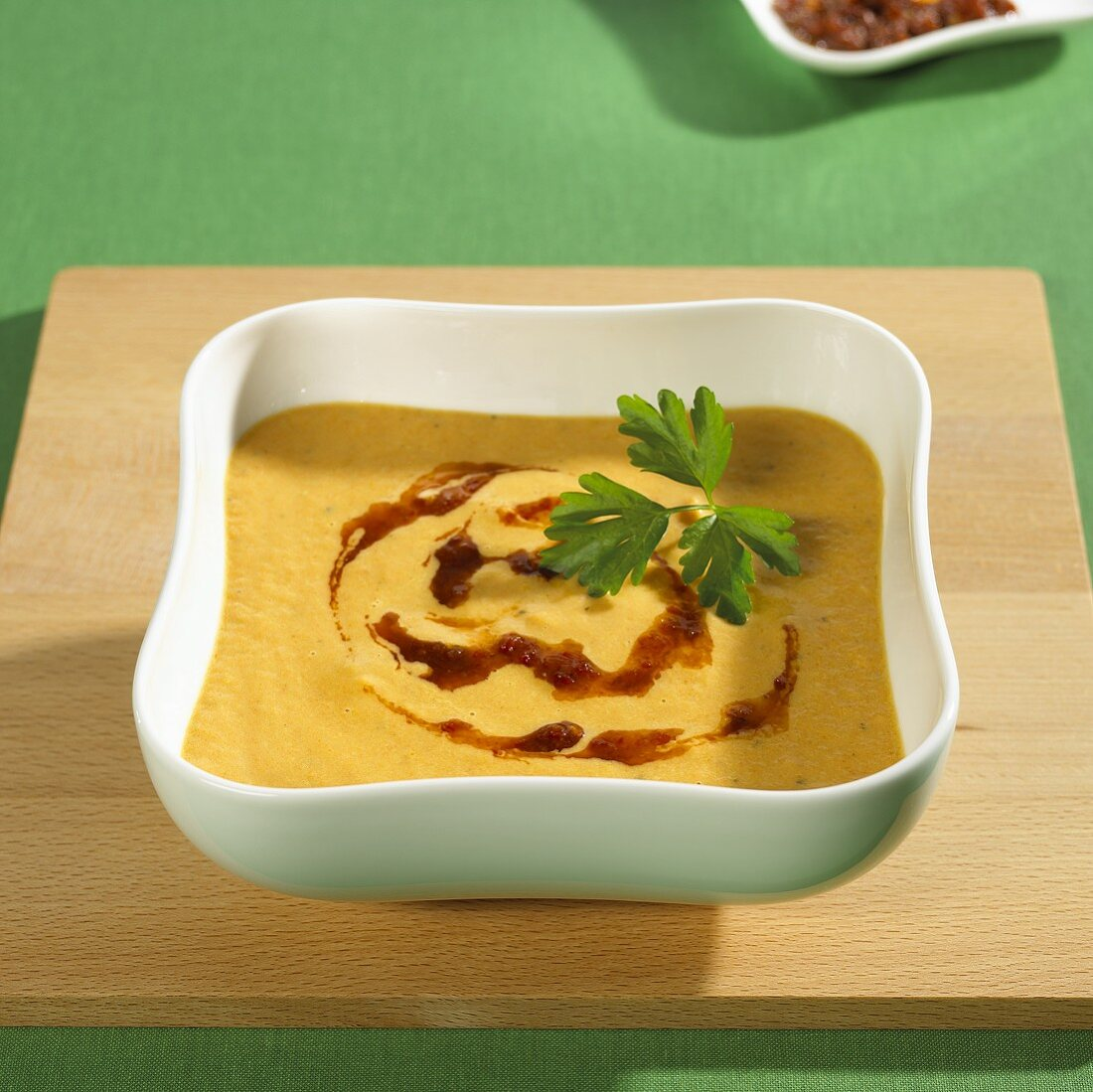 Carrot and orange soup with tomato pesto