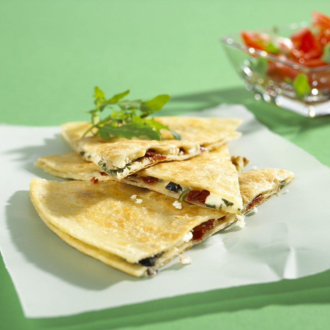 Quesadilla filled with olives, dried tomatoes, feta