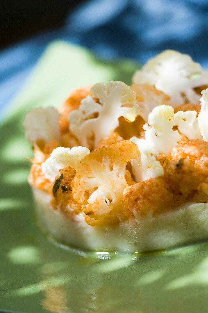Cooked and marinated cauliflower on cauliflower puree