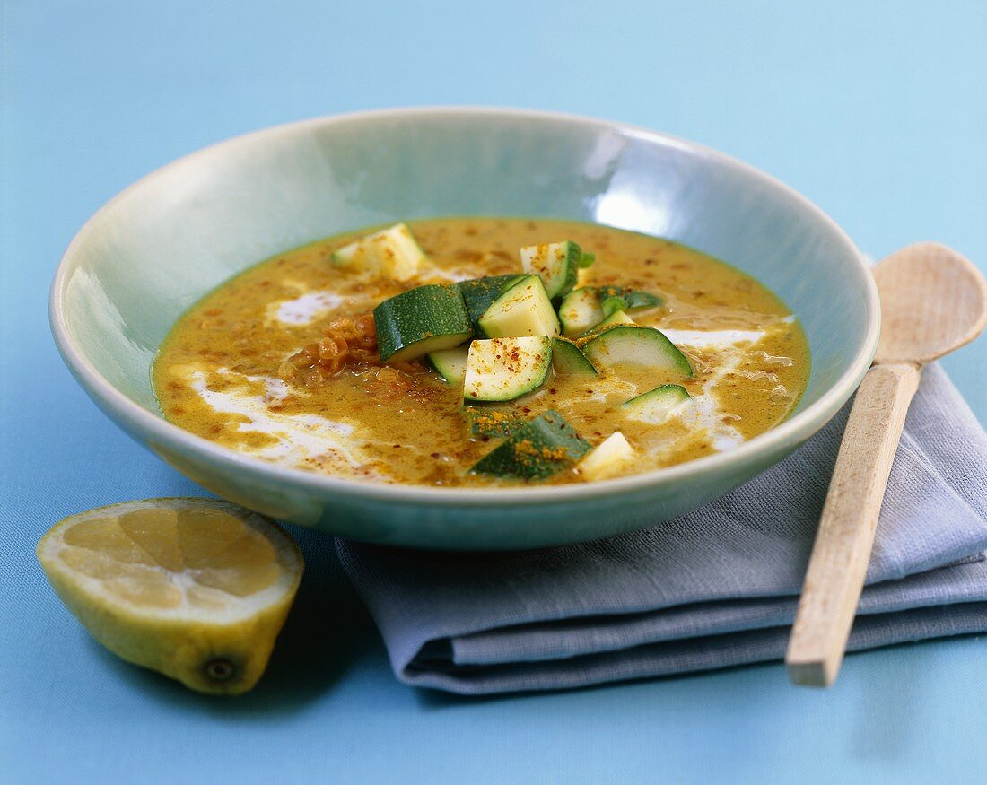 A plate of lentil & coconut soup with courgette & curry powder