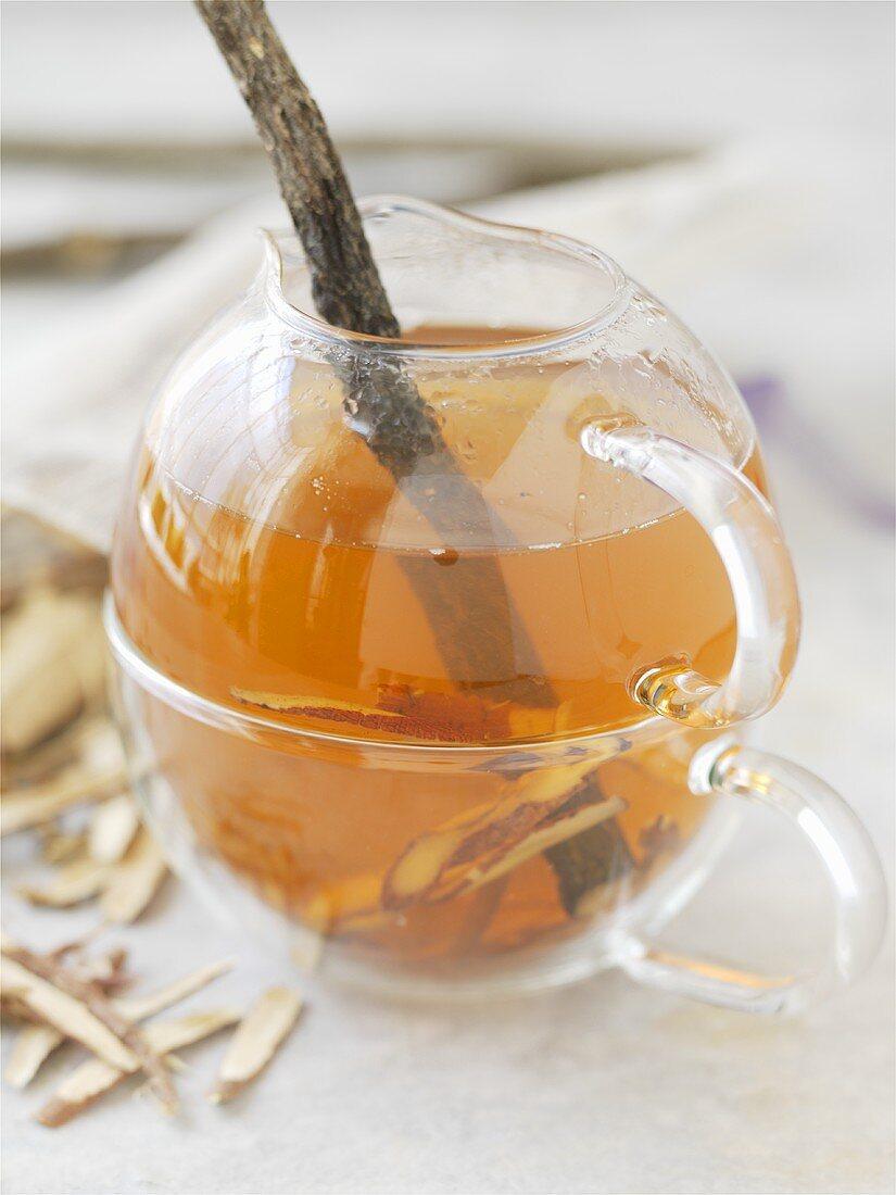 A small pot of liquorice tea with liquorice