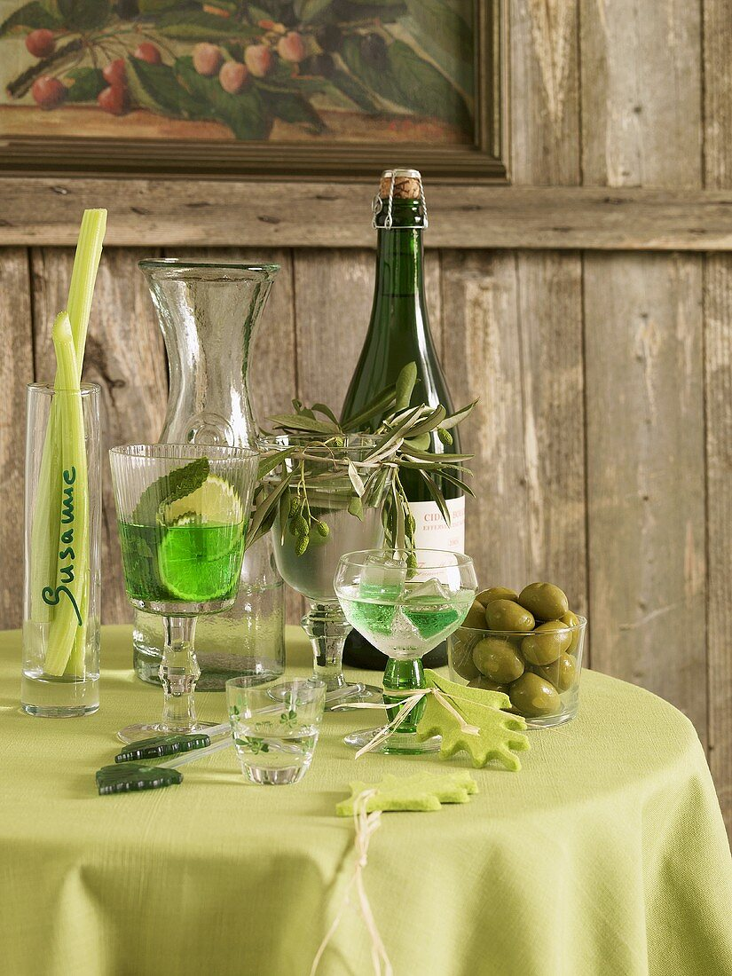 White wine, aperitif and olives on small table