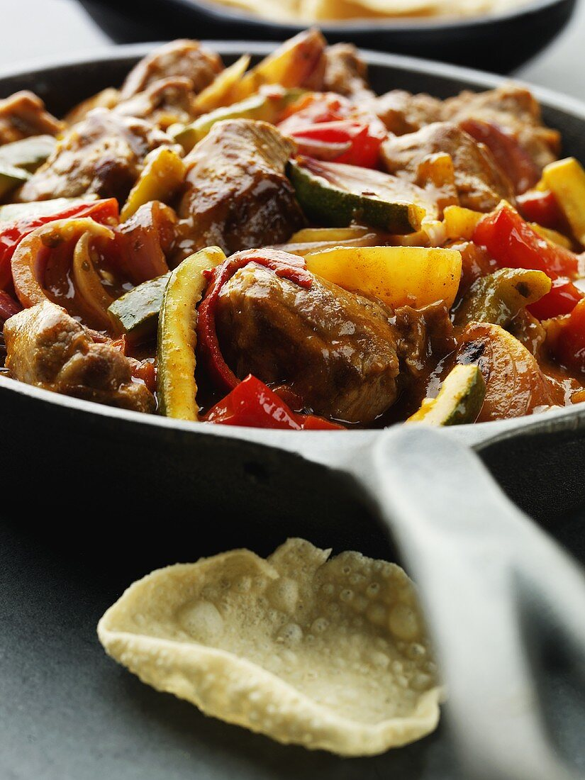 Lamb and vegetable curry in a frying pan