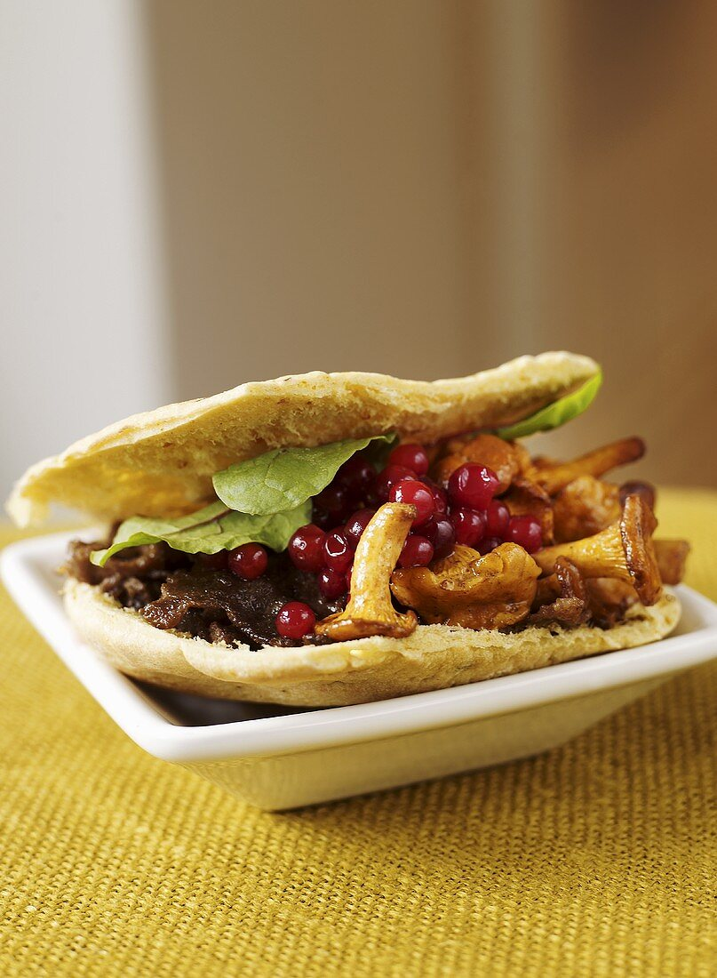 Flatbread filled with elk kebab meat and chanterelles
