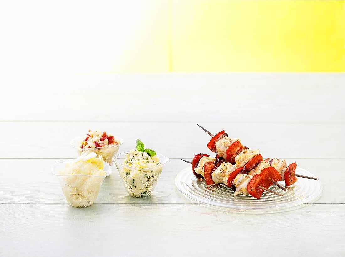 Grilled chicken kebabs with three different variations on polenta