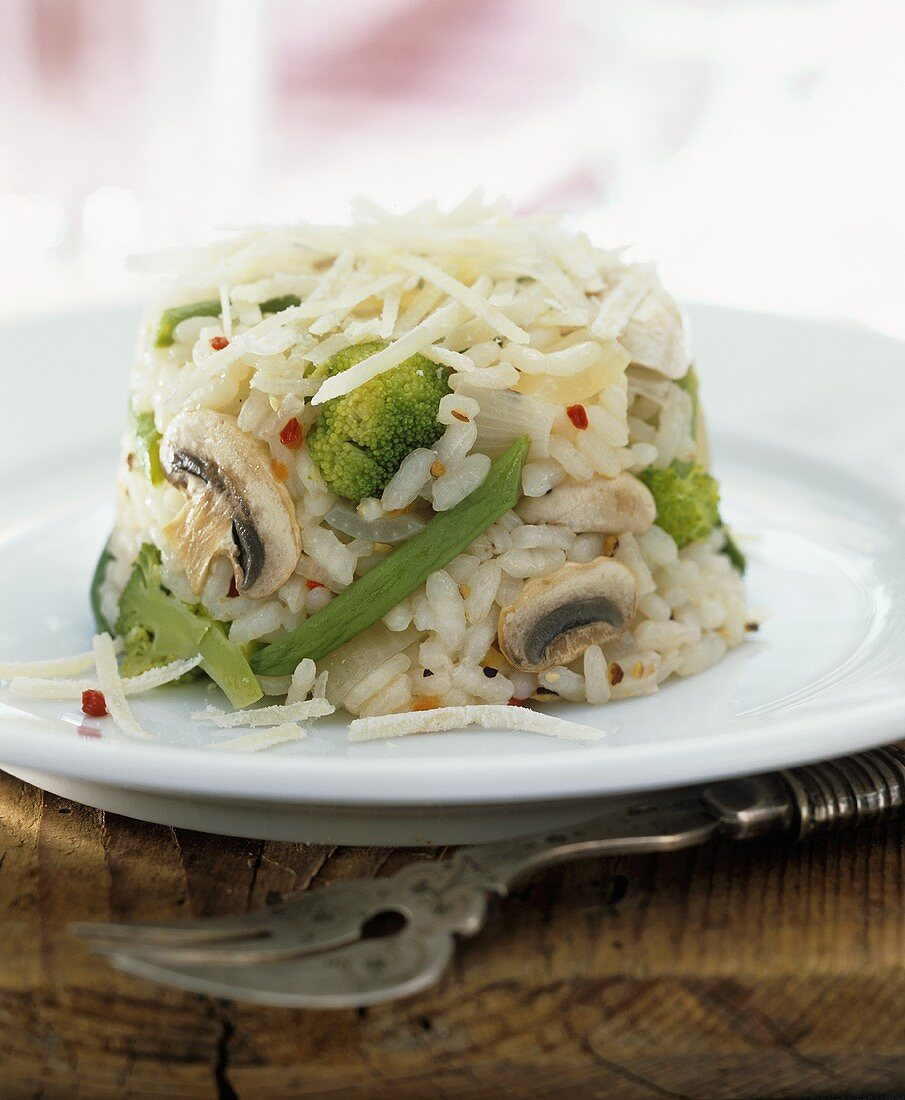 Vegetable rice with mushrooms (turned-out of a mould)