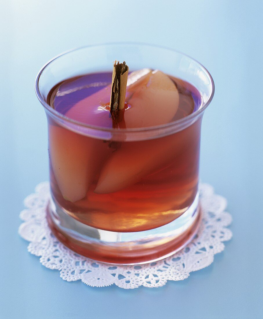 Poached pear in mulled wine jelly in a glass