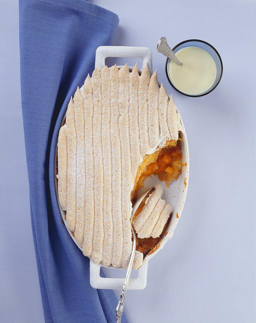 Apricot bread pudding (Scheiterhaufen, 'Log pyre') with custard