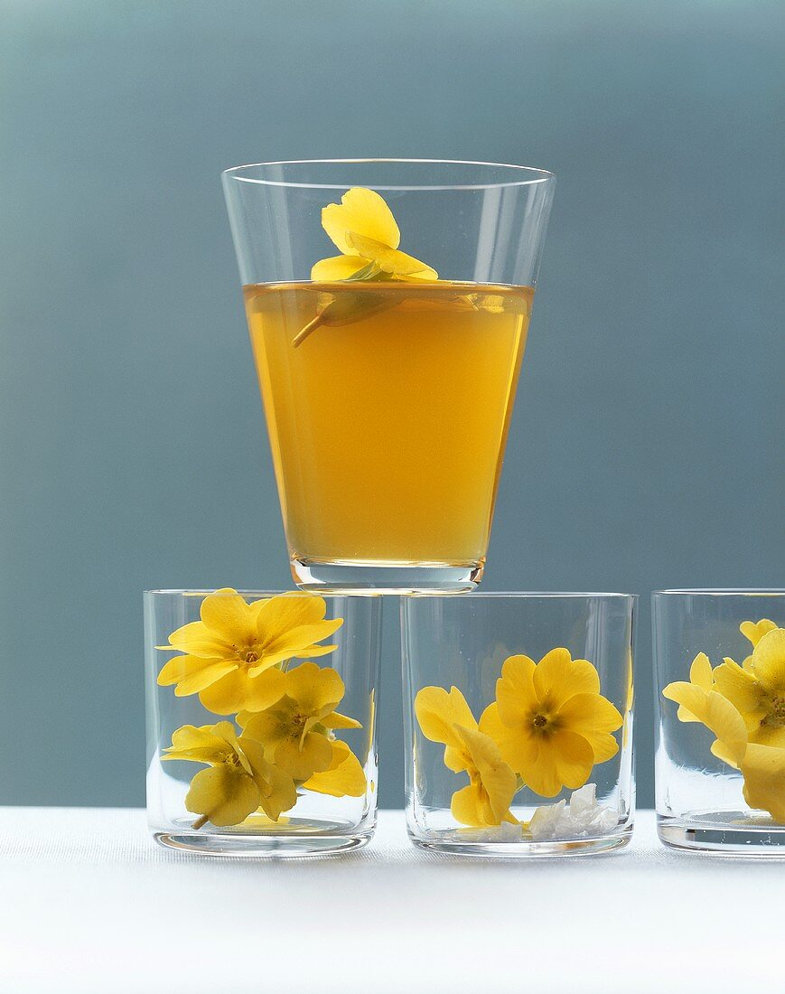 Vegetable consommé with primroses in glasses