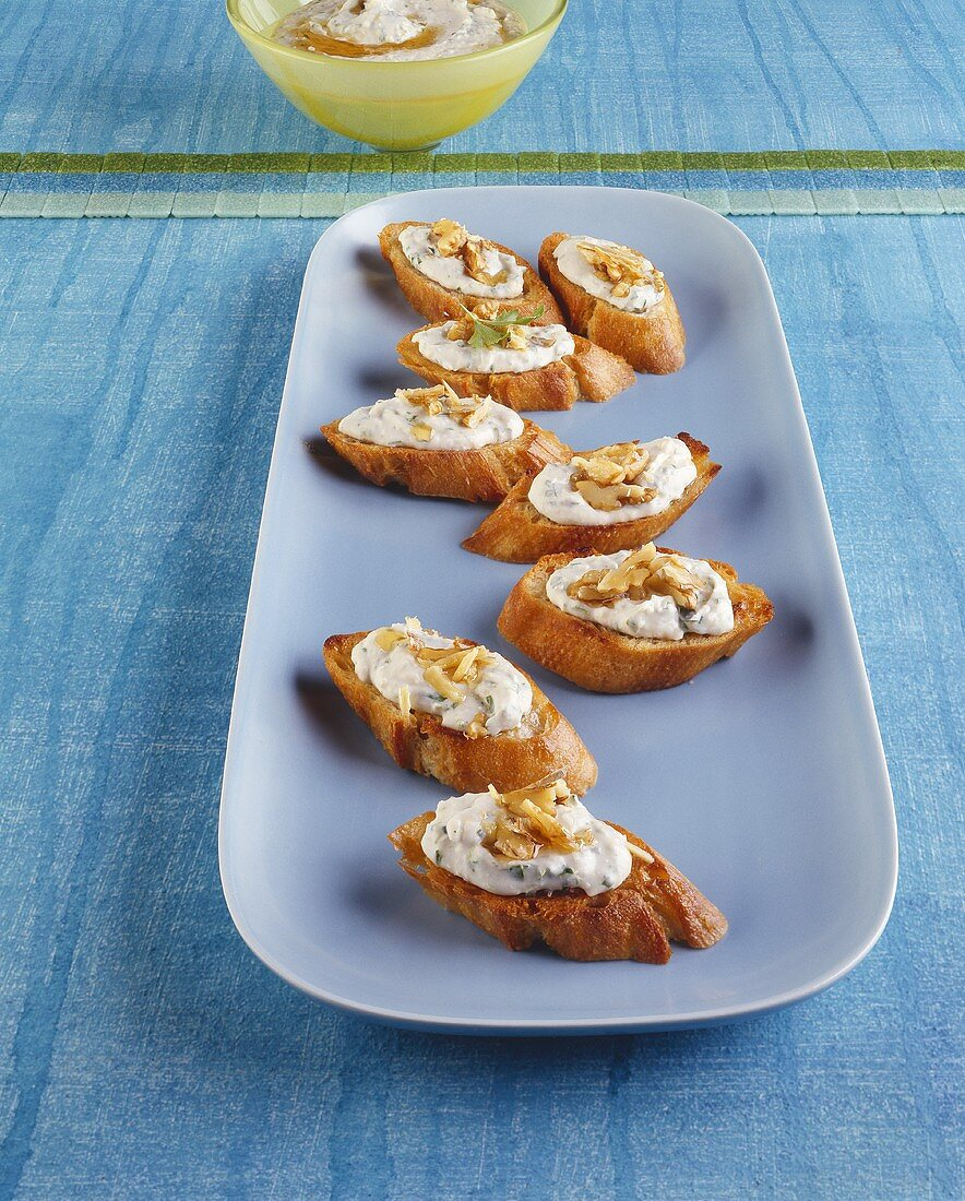 Crostini topped with garlic and bean puree