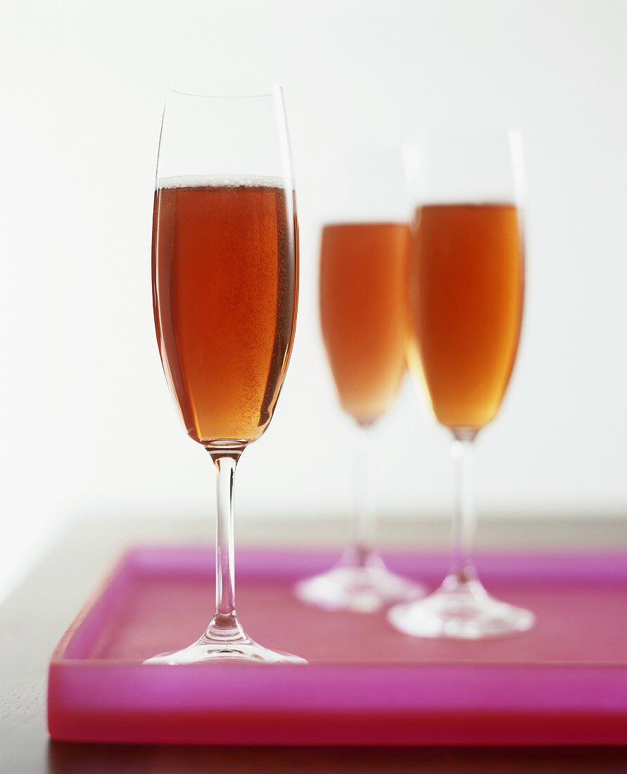 Three glasses of sparkling wine cocktail