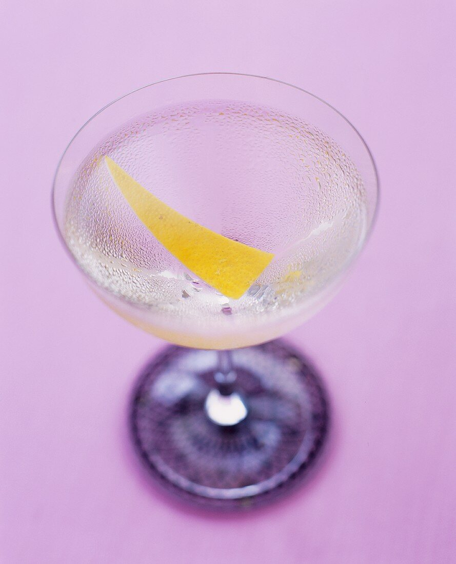 A glass of Martini with lemon