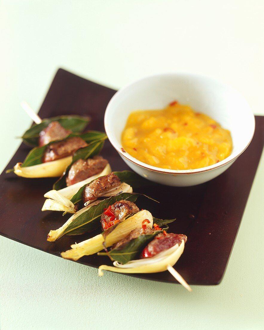 Grilled lamb and onion kebab with mango chutney