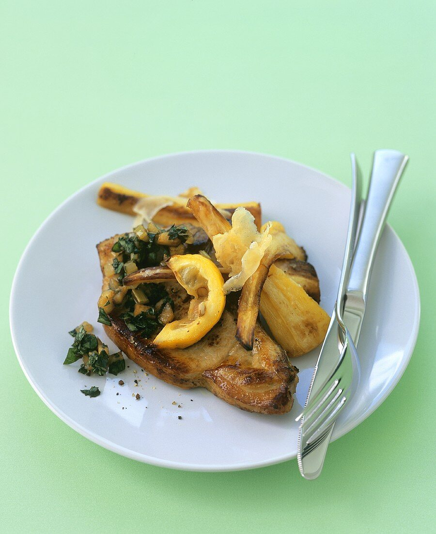 Pork chops with roasted parsnips and lemon
