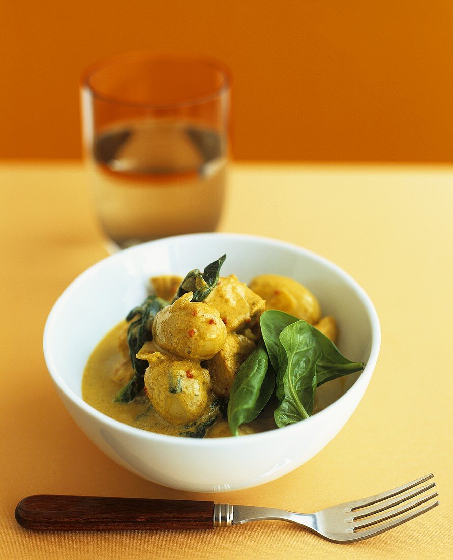 Sea bream and mushroom curry with spinach leaves