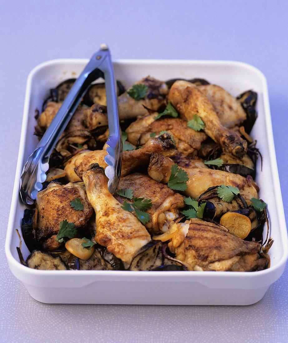 Chicken legs with onion, aubergine and lemon