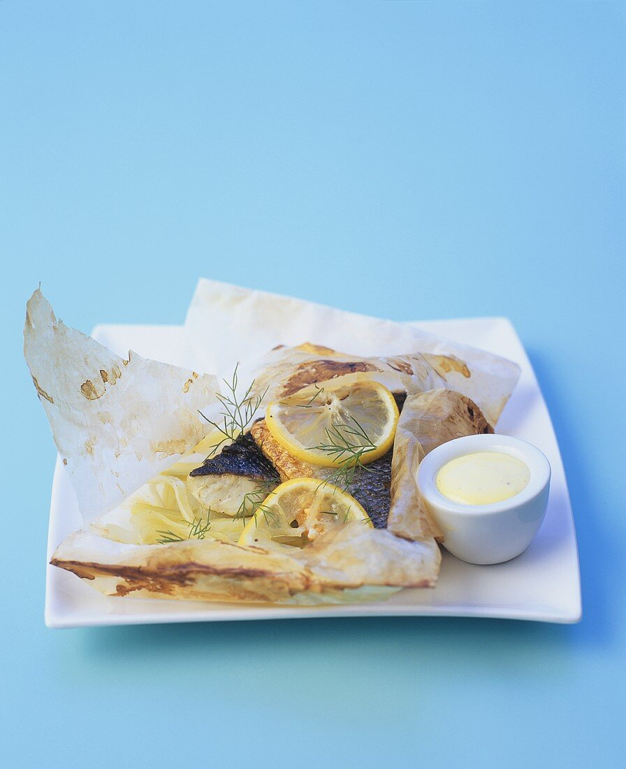Sea bass with fennel and lemon en papillote, mayonnaise
