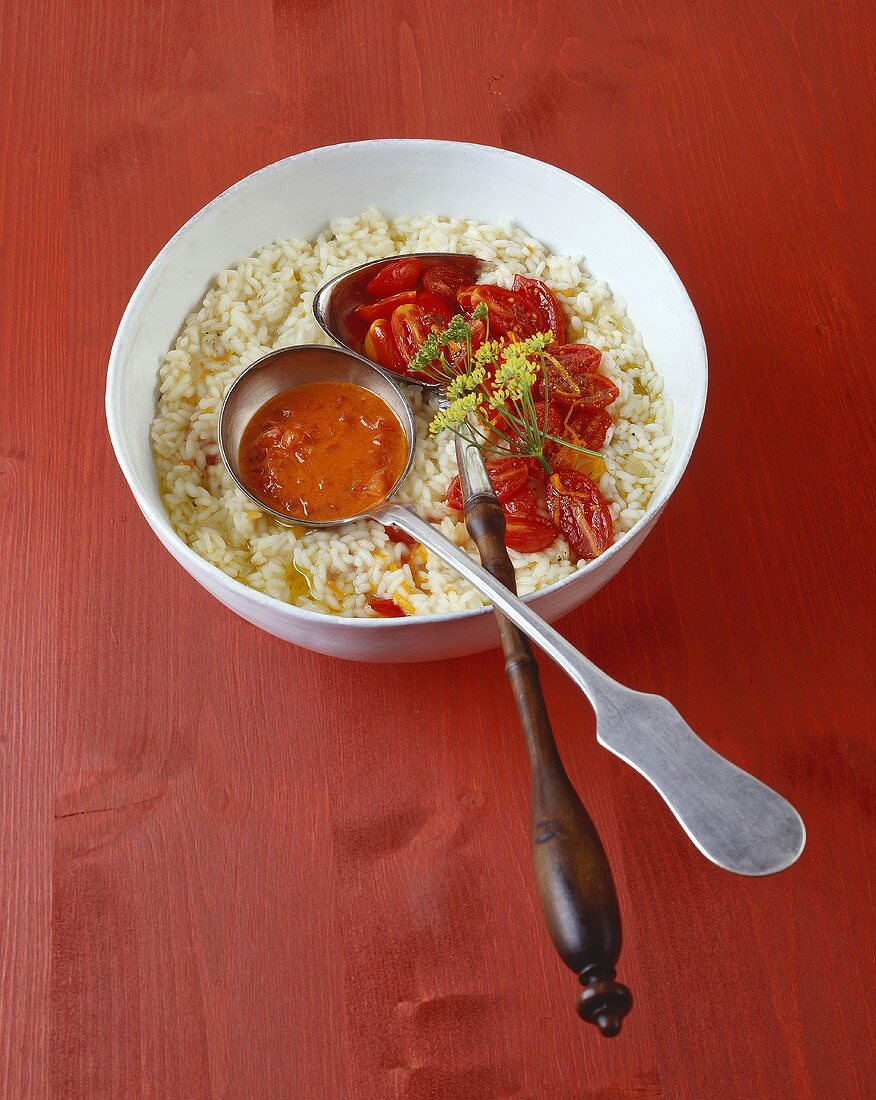 Orange risotto with tomatoes