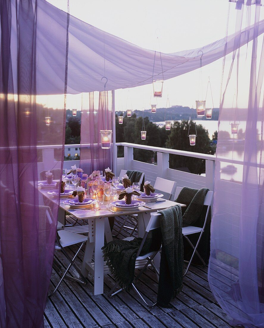Table laid for special occasion out of doors at twilight