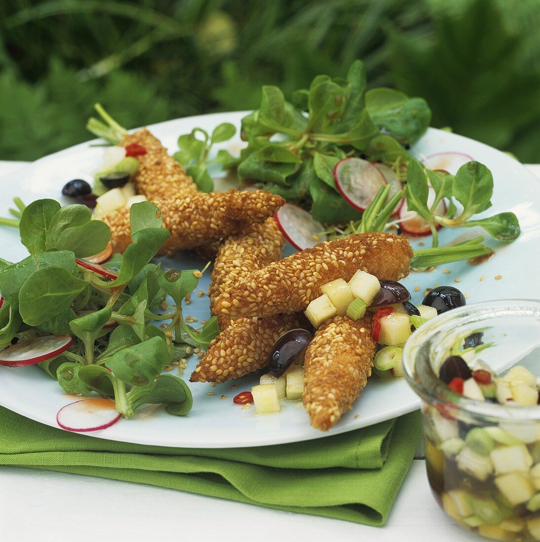 Breaded carrots with corn salad and grape and apple salsa