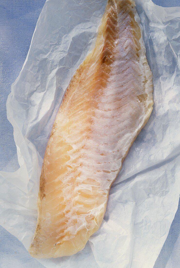 Redfish fillet on paper