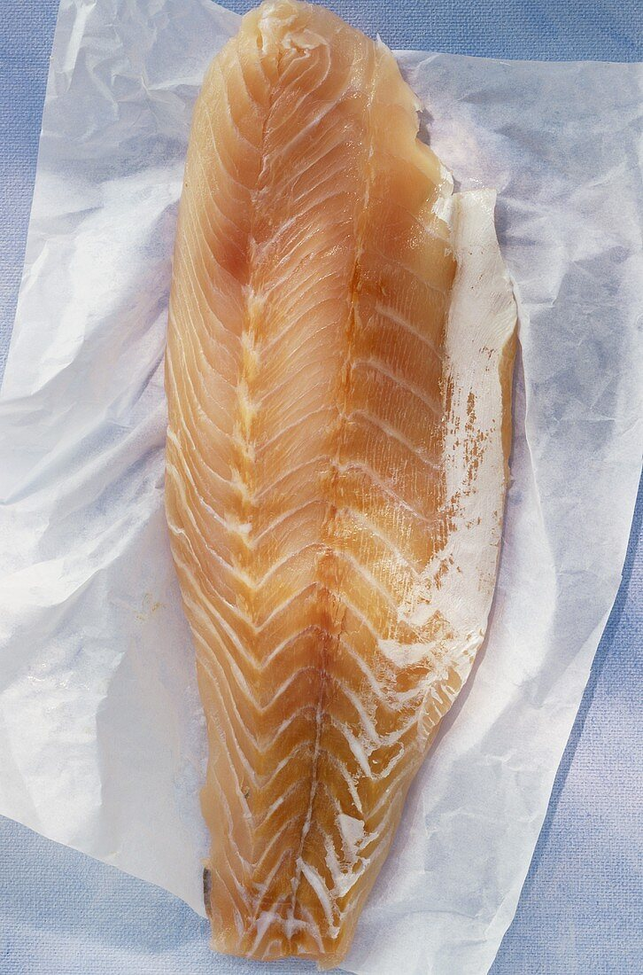 Nile perch fillet on paper