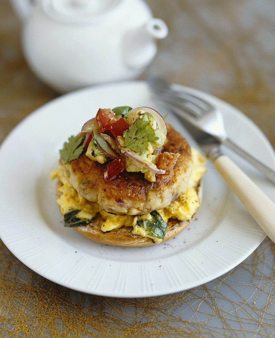 Chicken burger with scrambled egg on bread roll