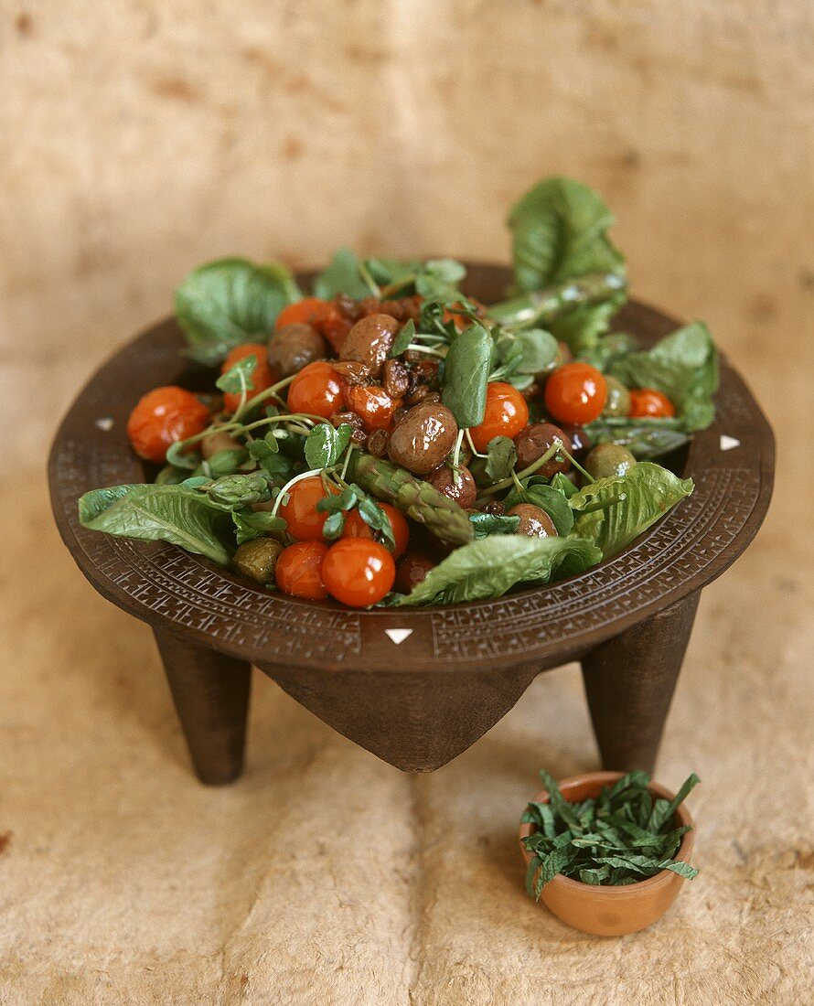 Vegetable salad with cherry tomatoes and olives