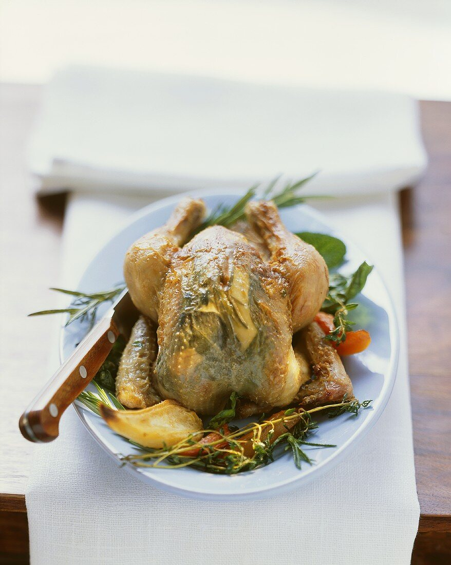 Roast chicken with herbs stuffed under the skin
