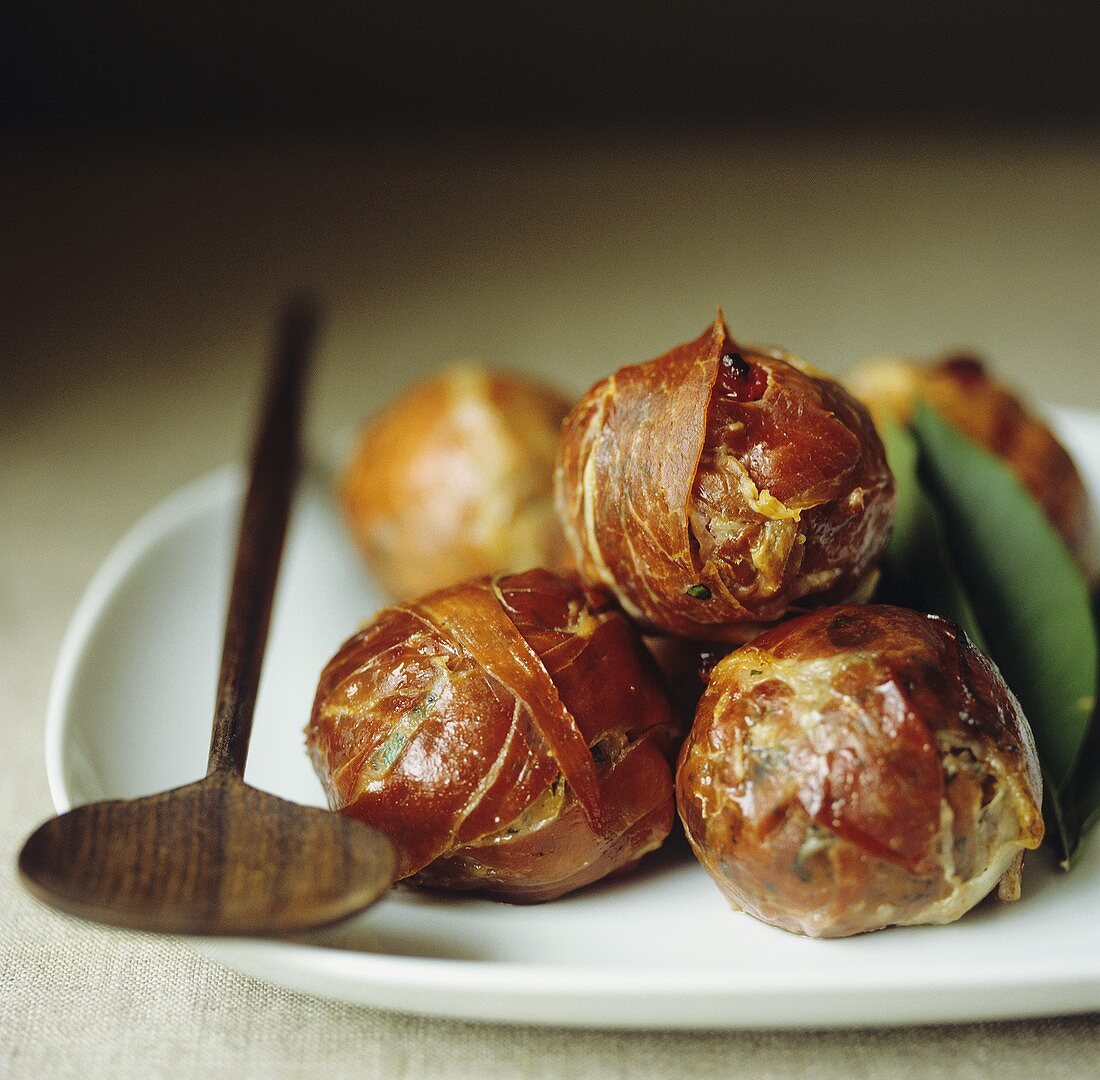 Meatballs with cranberries, wrapped in ham