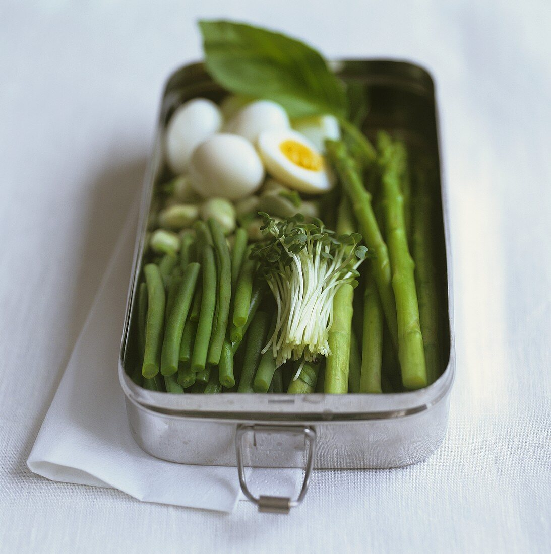 Lunch box with vegetables an quails eggs