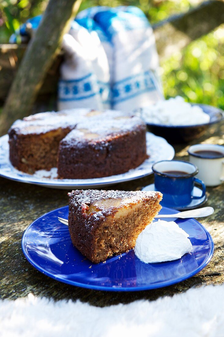 A slice of pear and chocolate cake with whipped cream