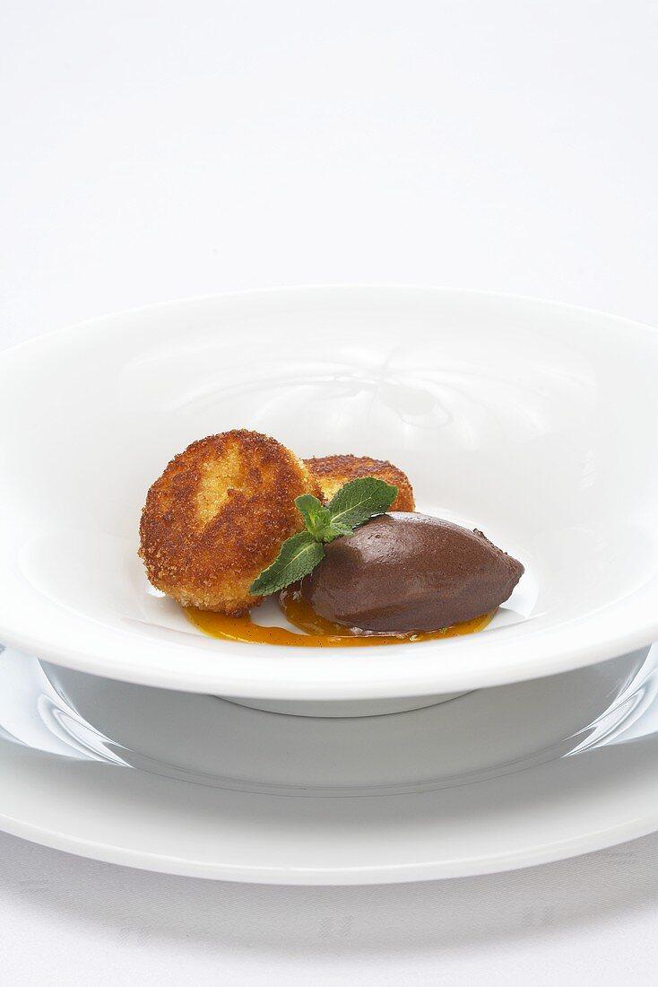 Potato cakes with mango and chocolate sorbet