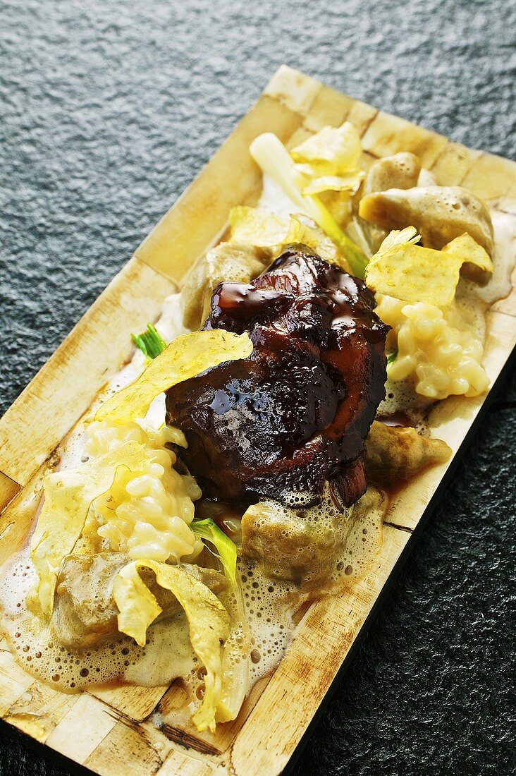 Braised veal cheeks with artichockes and risotto