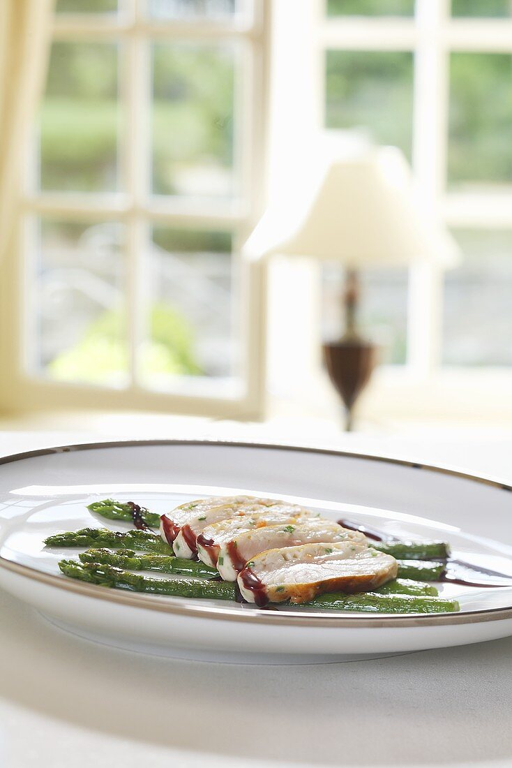 Sturgeon with smoked oil and grilled asparagus