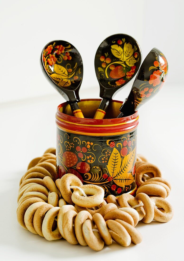 Bubliki (Russian bread rings) and a pot with wooden spoons