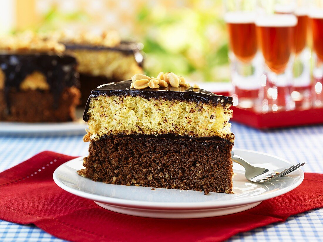 Piece of black & tan cake in front of cake with piece removed