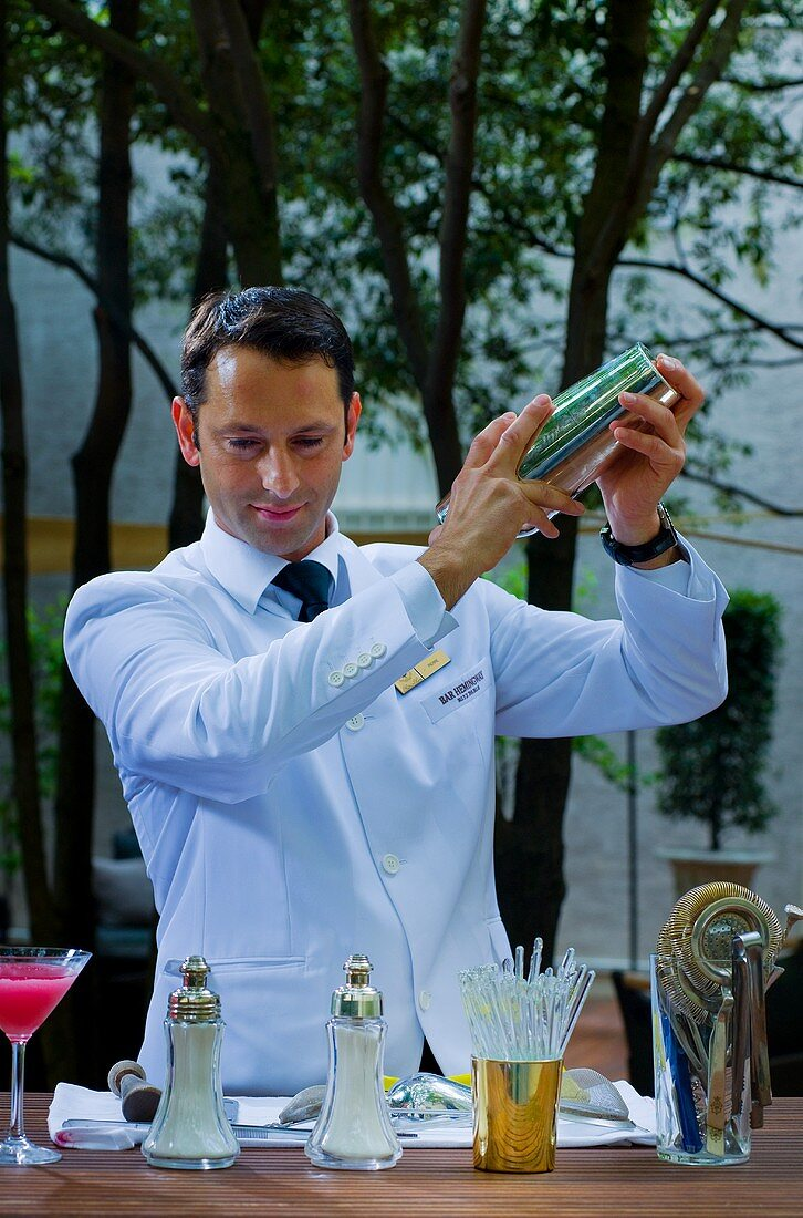 Bartender mixing cocktails