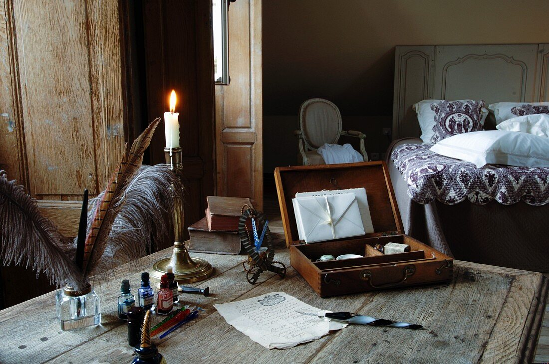 Writing paper on wooden table in bedroom