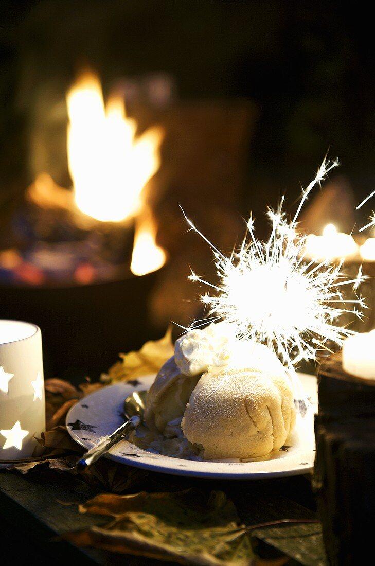 Apple dumpling with sparkler